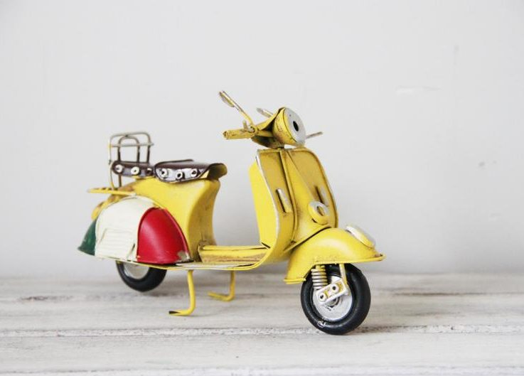 Yellow retro scooter, vintage, collectible, retro miniature, tin and rubber, yellow Italian scooter with Italian flag colours