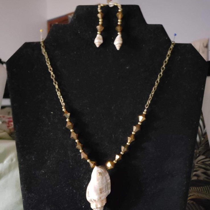Brown Swarovski Crystals and Conch Shells and Antique Chain