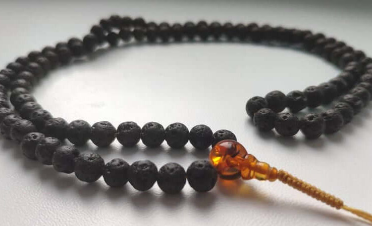 NOIR - 108 lava stone & baltic amber mala for meditation (size Ø6.2)