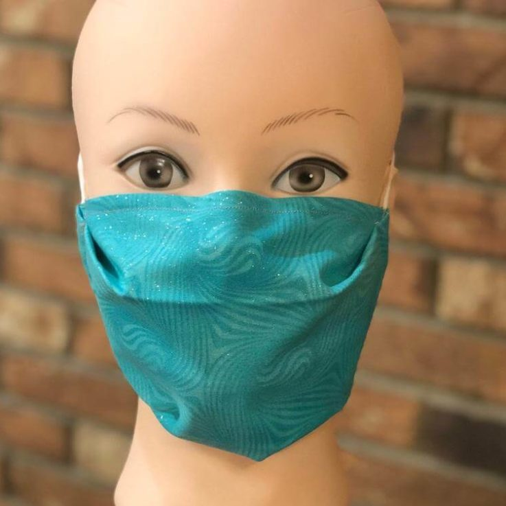 Face Mask with adjustable nose piece, filter pocket, and one Carbon filter.
