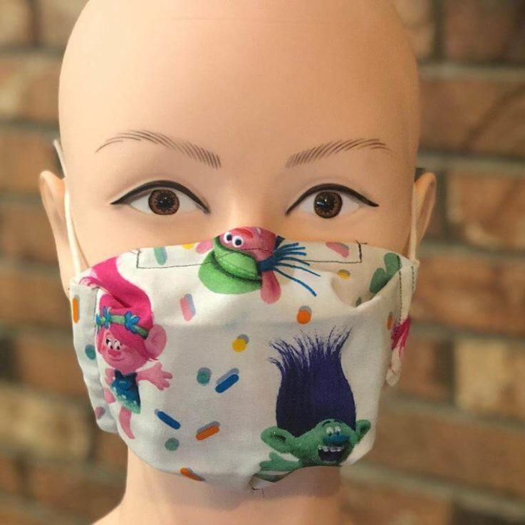 Kids face mask with adjustable nose piece, filter pocket, and one activated carbon filter.