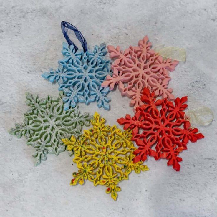 Brightly coloured handmade Jesmonite Christmas snowflake decorations