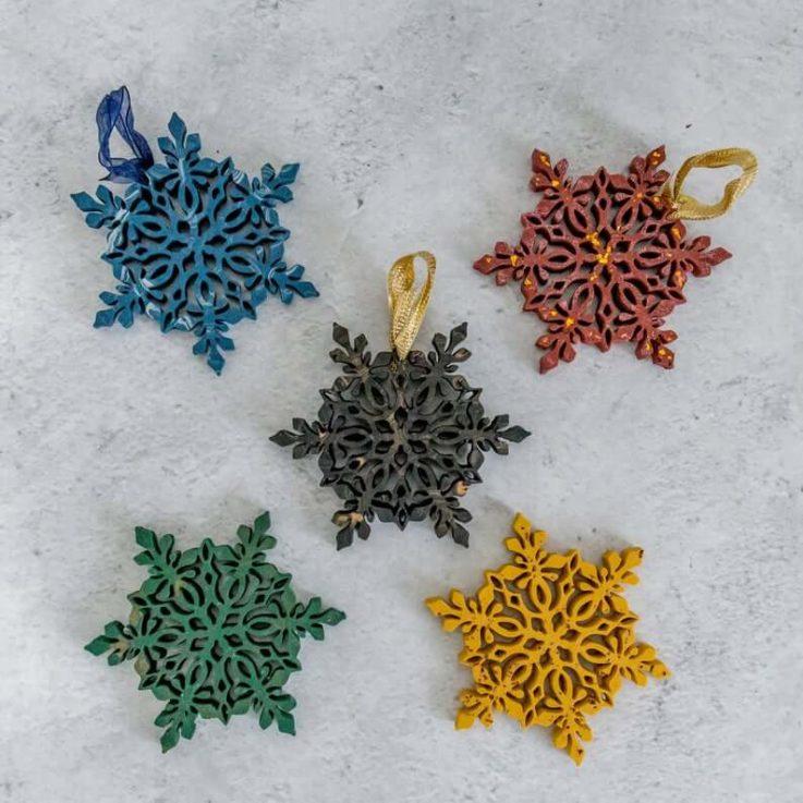 Dark coloured handmade Jesmonite Christmas snowflake decorations