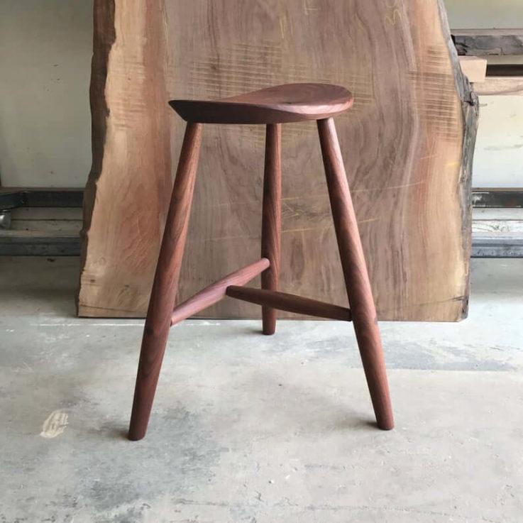 Walnut saddle stool